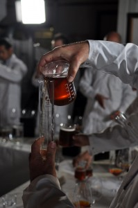 Image of pouring Ambassador beer from beaker to measuring cylinder