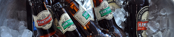 Banner image showing bottles of Hawthorn Brewing beers