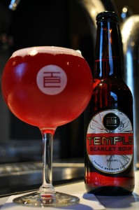 Photo of a full glass and bottle of the new Temple Scarlet Sour