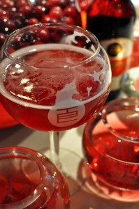 Photo of Temple's Scarlet Sour beer among cranberries