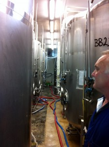 An inside view of Harrington's brewery showing rows of crowded tanks