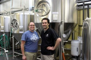 Sam Fuss and Luke Scott stand in front of the Prickly Moses brewery tanks