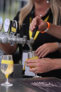 Hands pouring tastings of beer at the Ballarat Beer Festival