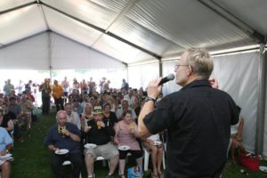 Chuck captures the crowd's attention with just a small plastic cup of James Squire Amber Ale.