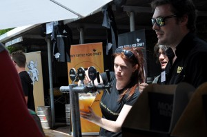 Staff pour Moo Brew beers at the festival