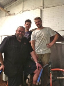 Kjetil Jikiun with Moon Dog's Karl and Josh stand in front of the Moon Dog brewhouse in their brewery.