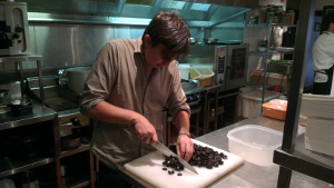 Andrew McConnell preparing prunes In 4 Pines' kitchen