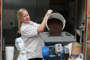 Red Hill's Karen Golding gets stuck into the milling...