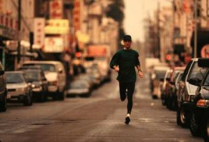 A man runs down a city street