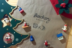 Beerkary Bakery logo surrounded by Christmas decorations