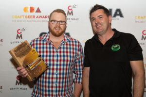 Hope Brewhouse's Matt Hogan accepting his award from Sandy Ross of Hopco