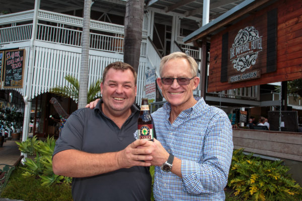 Fenlon and Hahn with a bottle of the old Eumundi Lager