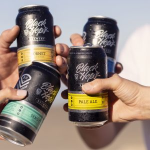 black-hops-cheers-cans-beach