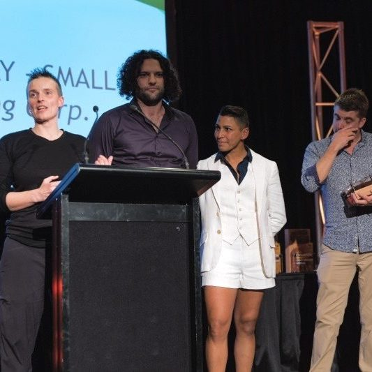 Jade Flavell and the Wheaty Brewing Corps team accept the prize for Champion Small Brewery